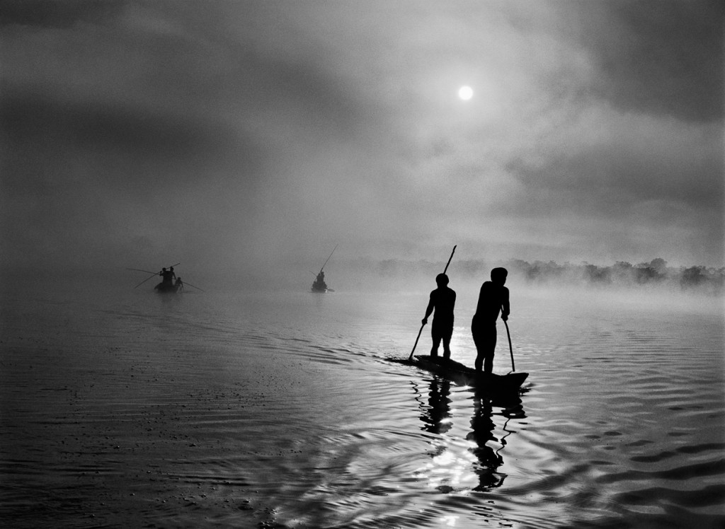 11. Salgado_ In the Upper Xingu region of Brazil's Mato Grosso state, a group of Waura Indians fish in the Puilanga Lake near their village